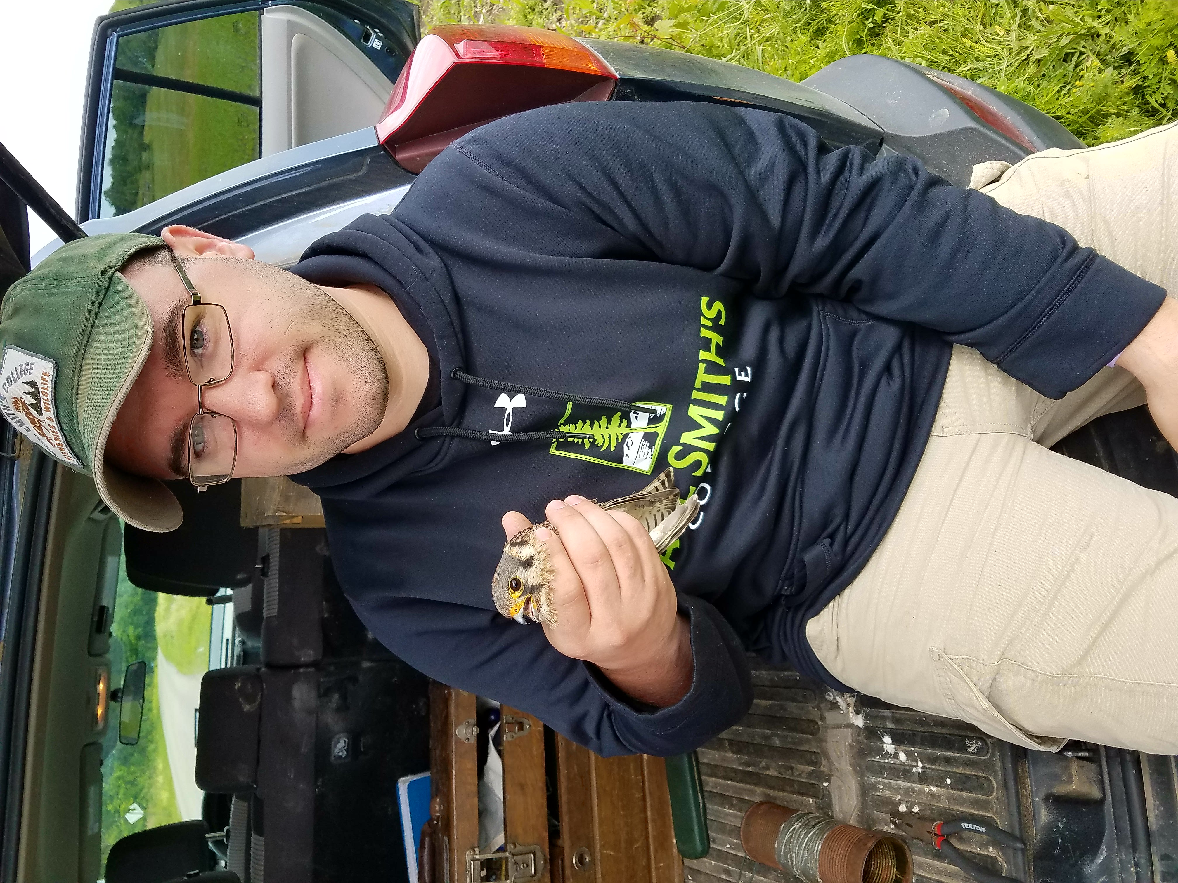 Connor with an American Kestrel