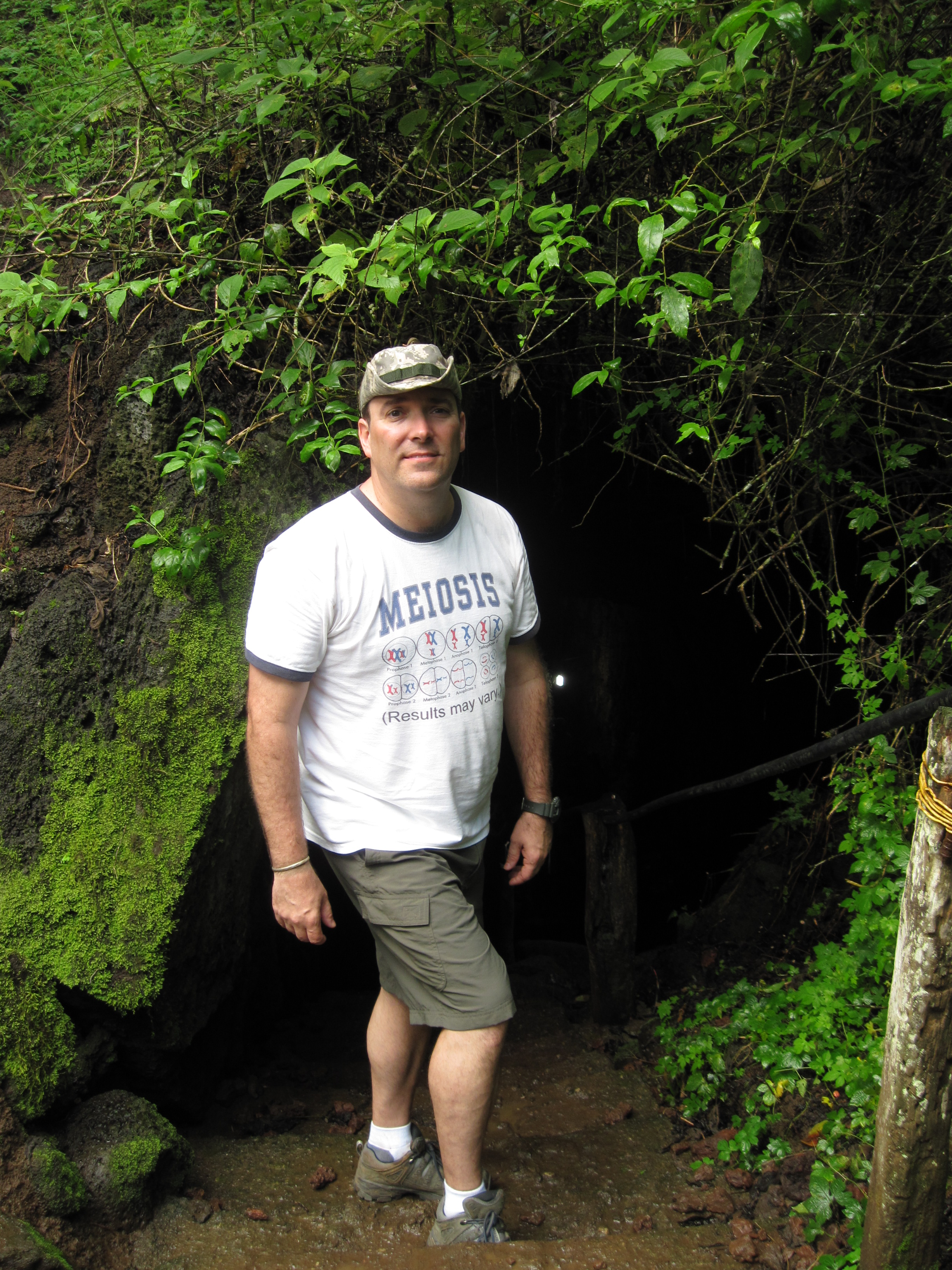 John about to enter a lava tube, Galapagos Islands, 2013