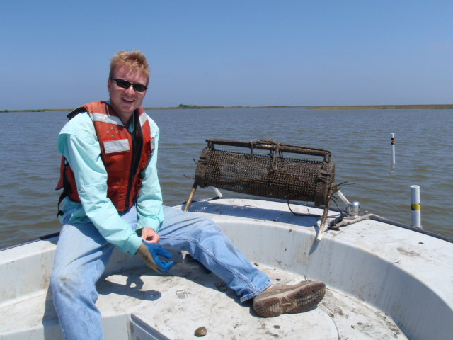 Graduate student Ben Eberline sampling oysters in Breton Sound, LA