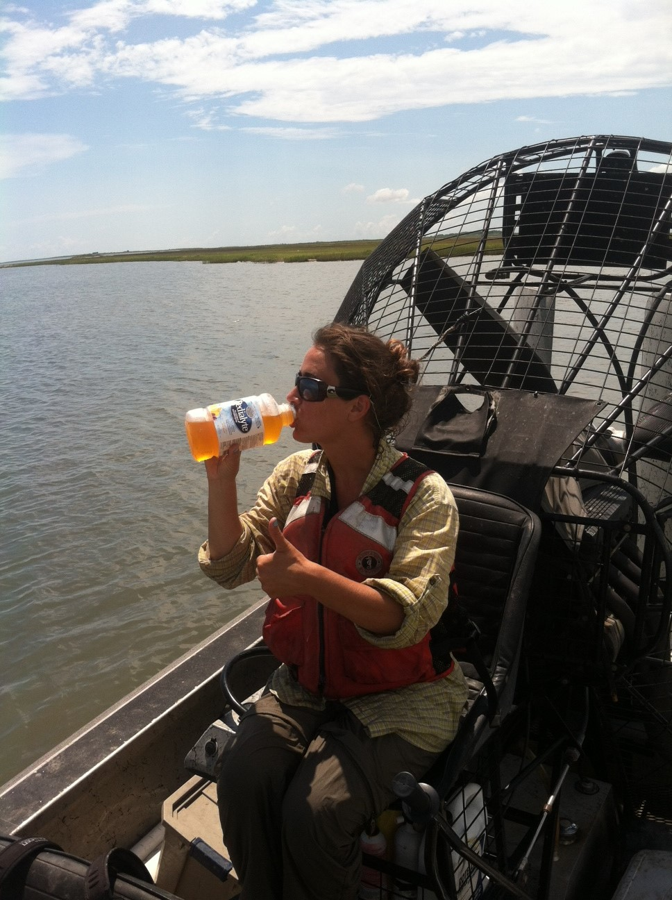 PhD Student Kristin DeMarco sampling SAV and staying hydrated.