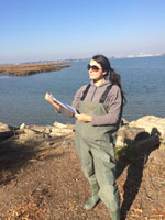 Nissa Kreidler collecting marsh data.
