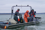 USGS and Tennessee Tech researchers working with a commercial fisherwoman to sample paddlefish with gill nets in Kentucky Lake on the lower Tennessee River