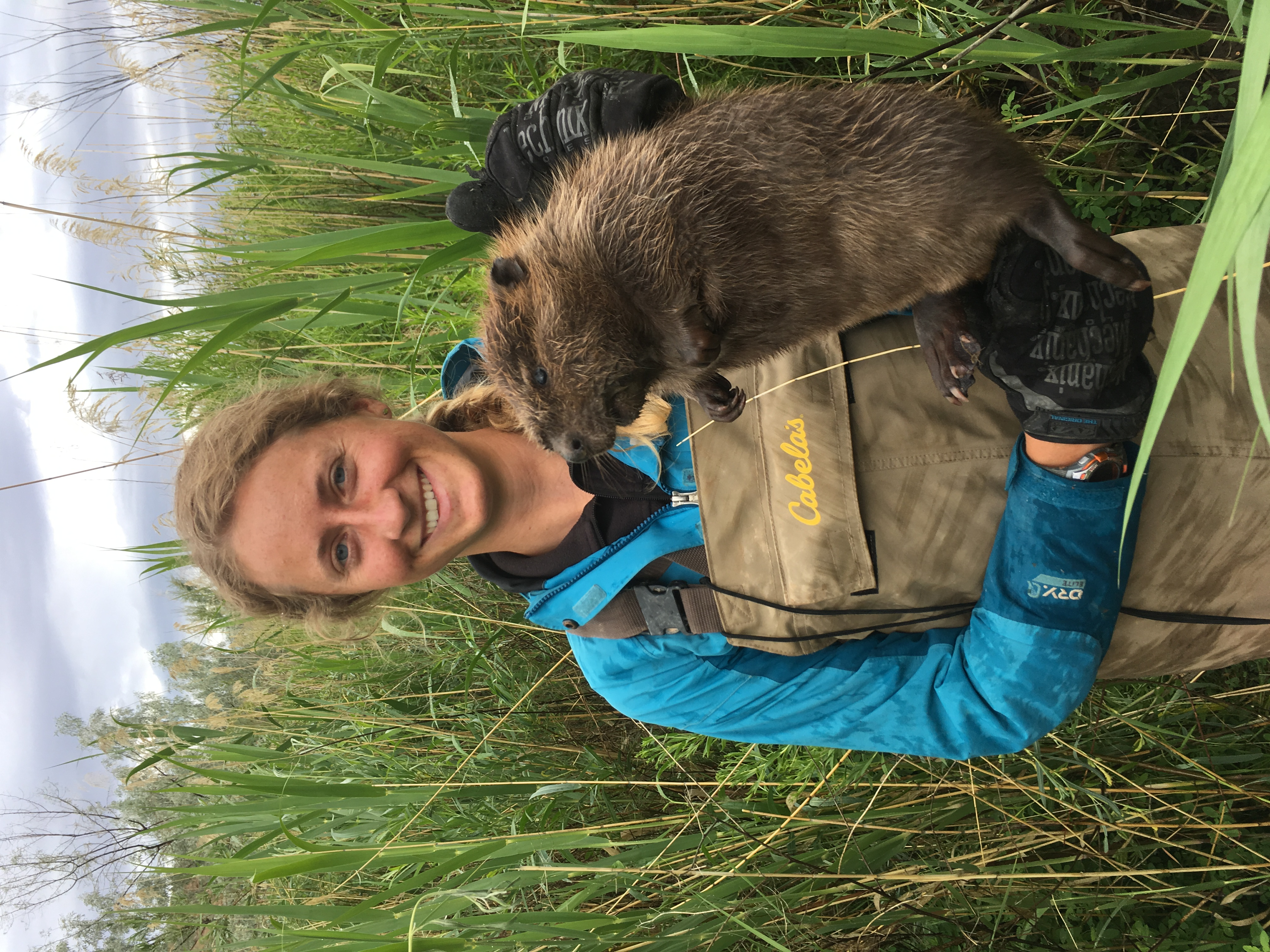 Emma Doden, a Masters student at Utah State University, with a captured beaver kit along the Price River, UT. The beaver kit was PIT-tagged and released for future monitoring.