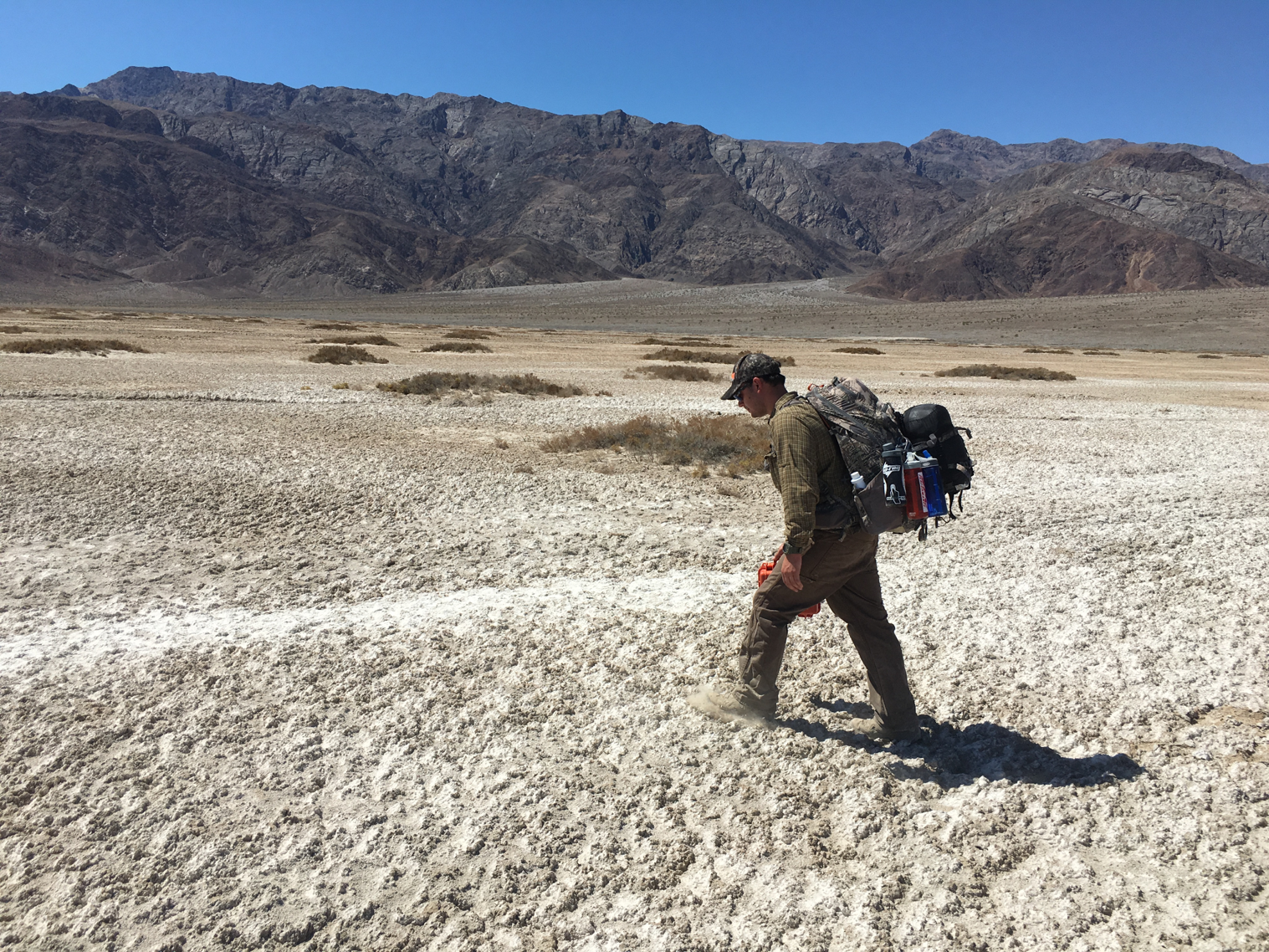 Arizona Coop Unit student walking across the floor of Death Valley on the way to sample a remote desert spring.