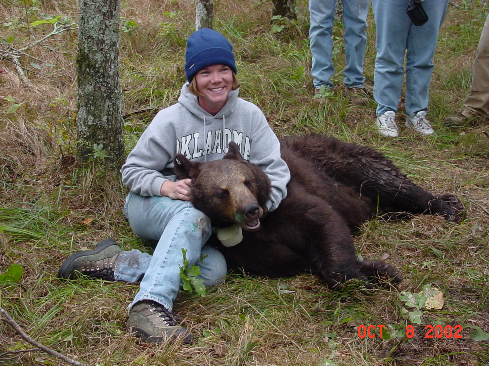 Sara Lyda with black bear captured in eastern Oklahoma.