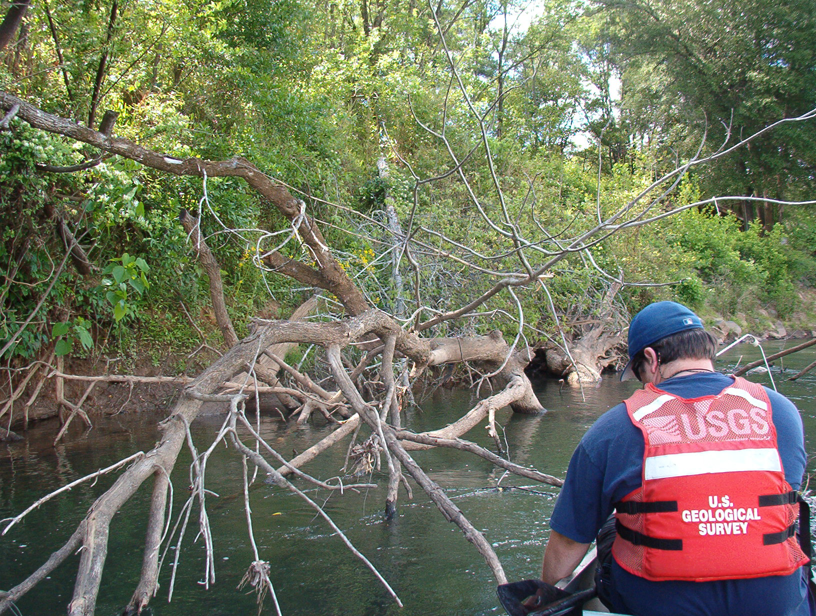 Tim Grabowski fixes the position of a radio-tagged robust redhorse in the Ocmulgee River, Georgia.