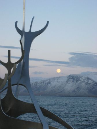 Moonrise over Mt. Esja as seen from the Sun Voyager in Reykjavik, Iceland.