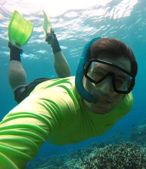 Tim Grabowski takes a selfie while snorkeling